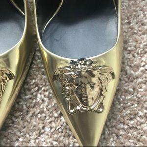 Golden Versace heels. (39 1/2)